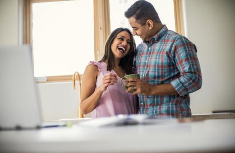 couple in kitchen enjoying coffee